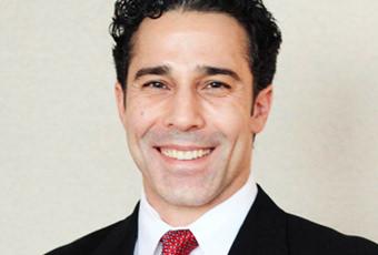 Dr. John D. Symbas
